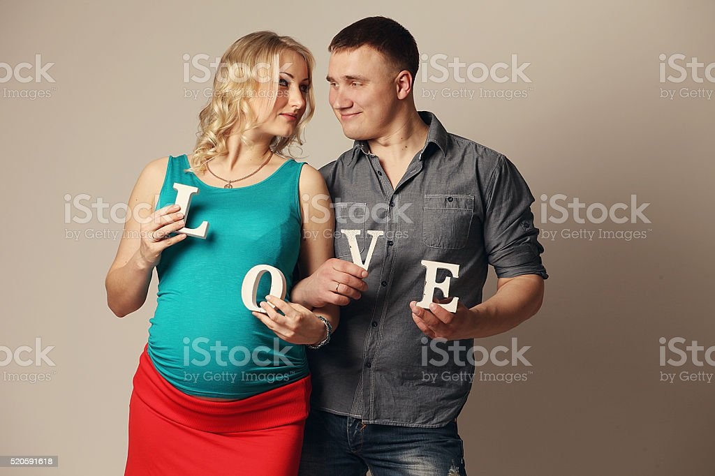 Pregnant woman with her husband stock photo