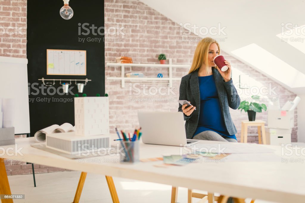 Pregnant woman Working in Her Office stock photo