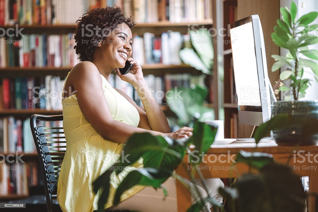 Pregnant Woman Working in Office stock photo
