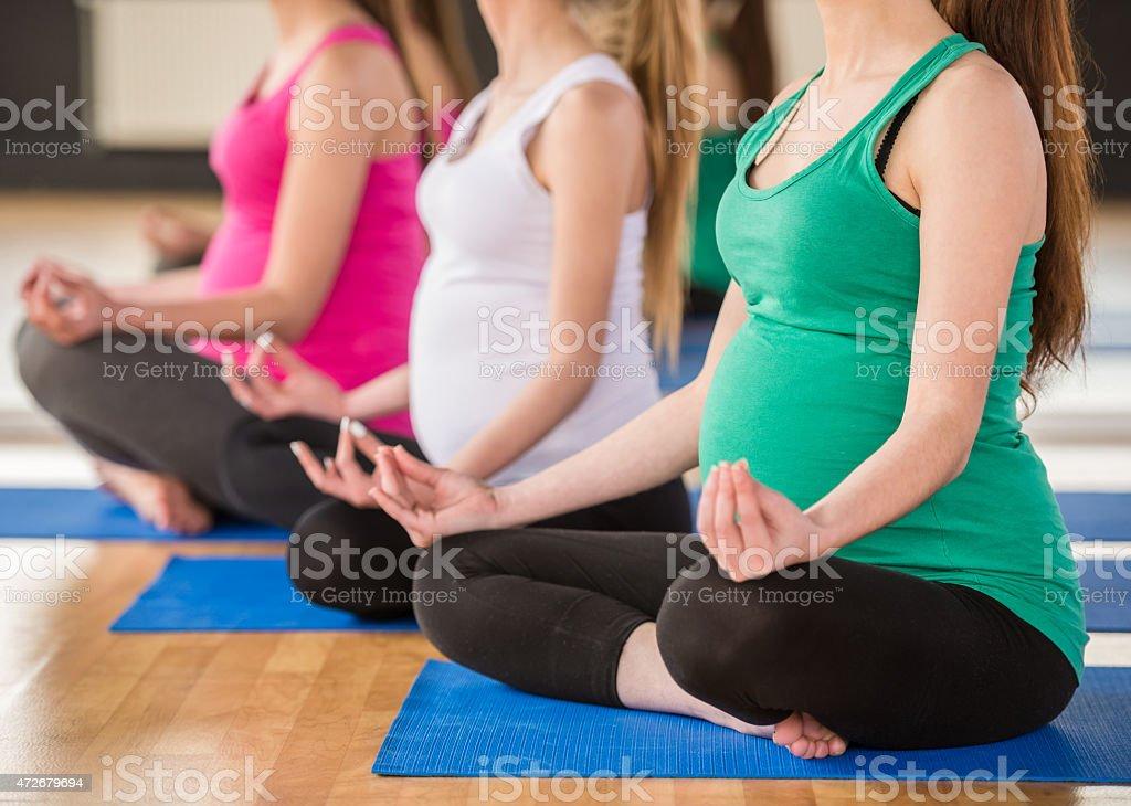Pregnant women at gym. stock photo