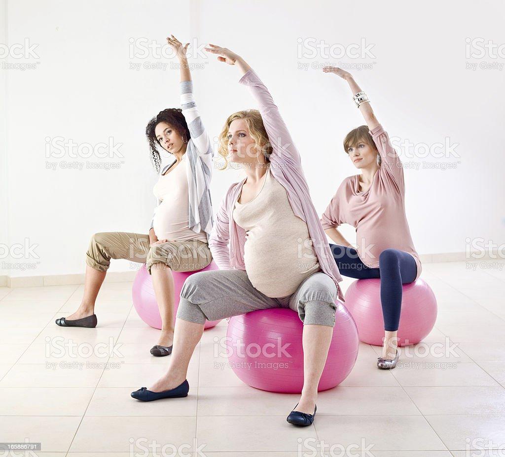Pregnant women doing exercises royalty-free stock photo
