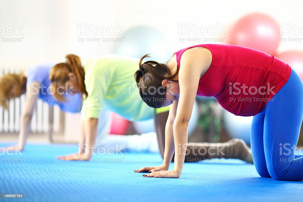 Pregnant women doing Pilates. stock photo