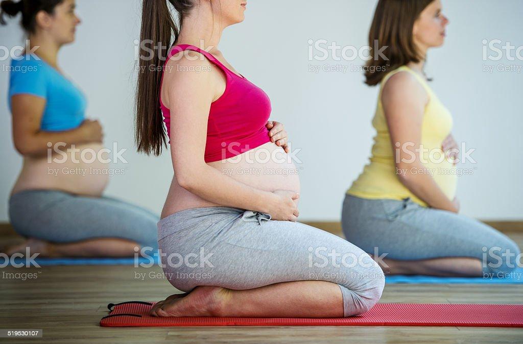 Pregnant women exercising stock photo