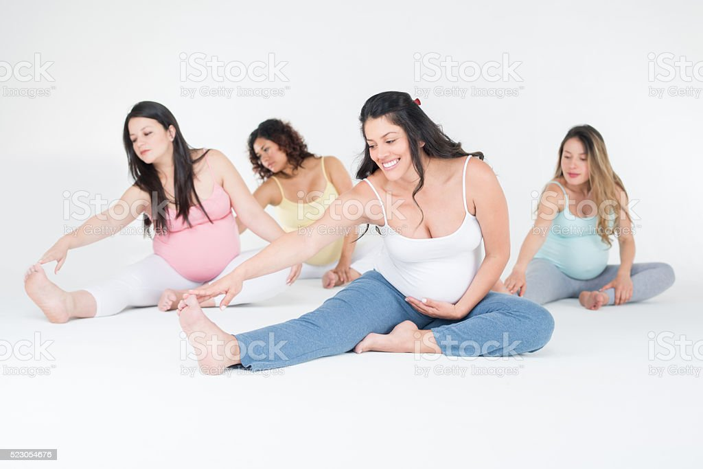 Pregnant women exercising together stock photo