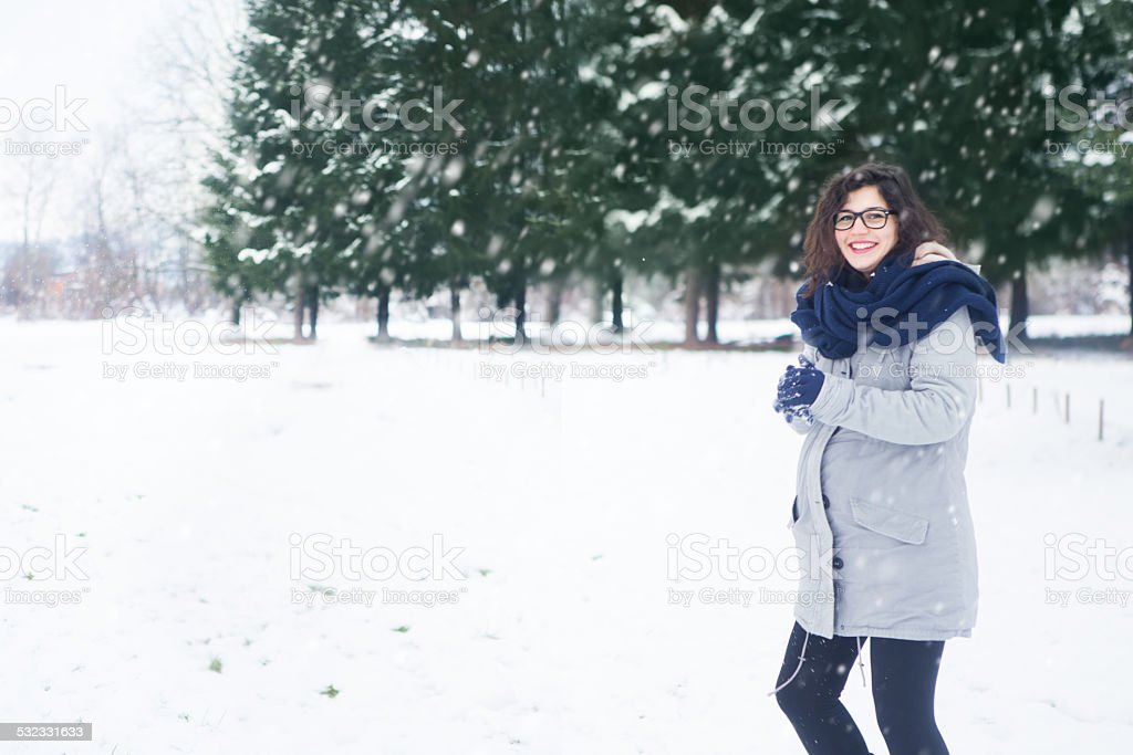 Pregnant women having fun on snow stock photo