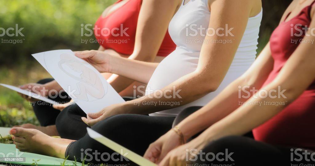 Pregnant Women In Prenatal Class With Images Of Baby stock photo
