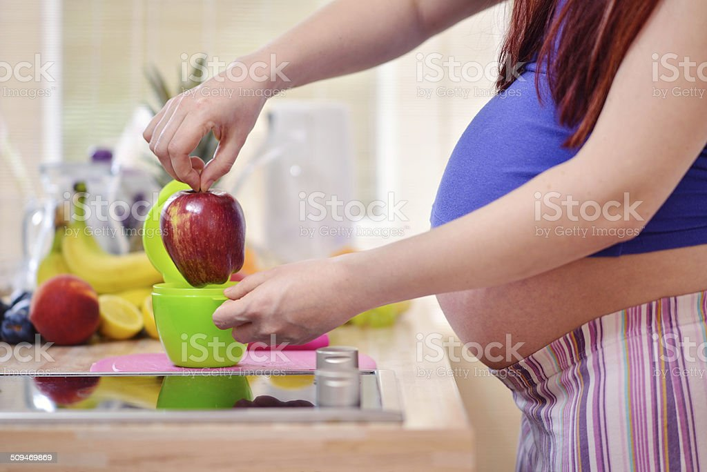pregnant women in the kitchen royalty-free stock photo