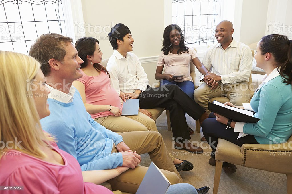 Pregnant Women With Partners At Ante Natal Class stock photo