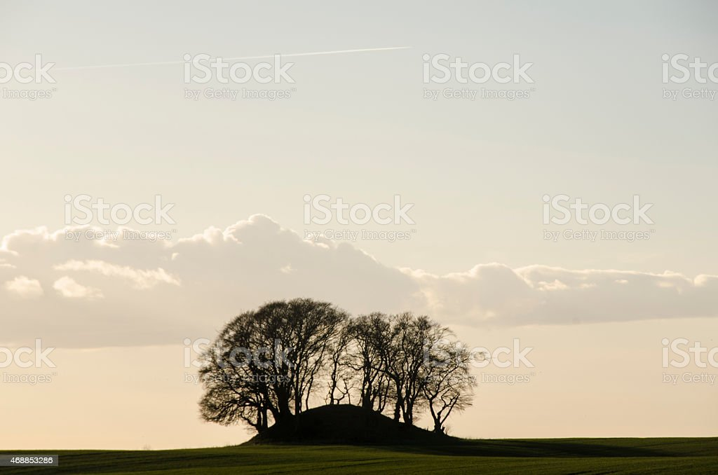 Prehistoric Burial Mound in Sunset stock photo