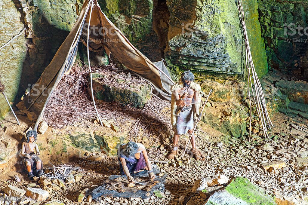 Prehistoric caveman family camp in cave of la Balme France stock photo