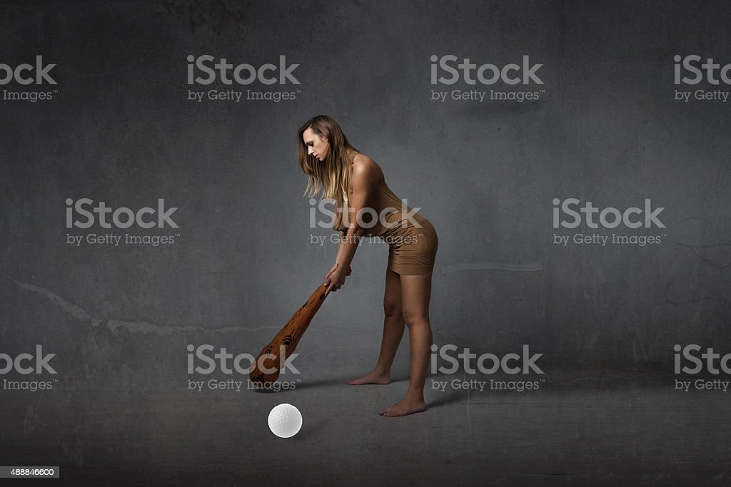 prehistoric first golfer concept stock photo