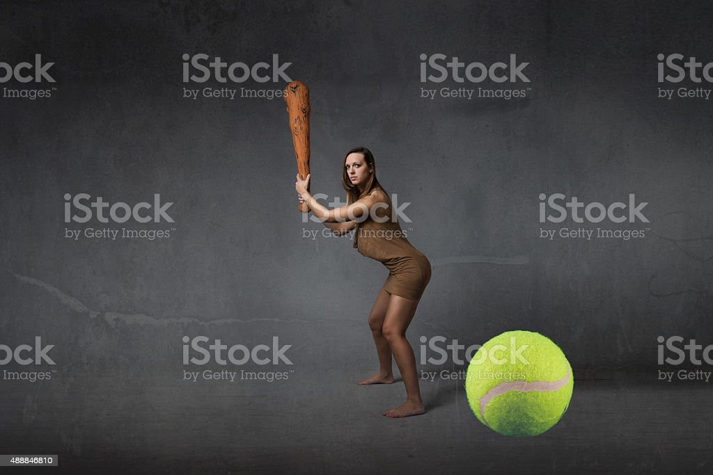 prehistoric first tennis player concept stock photo