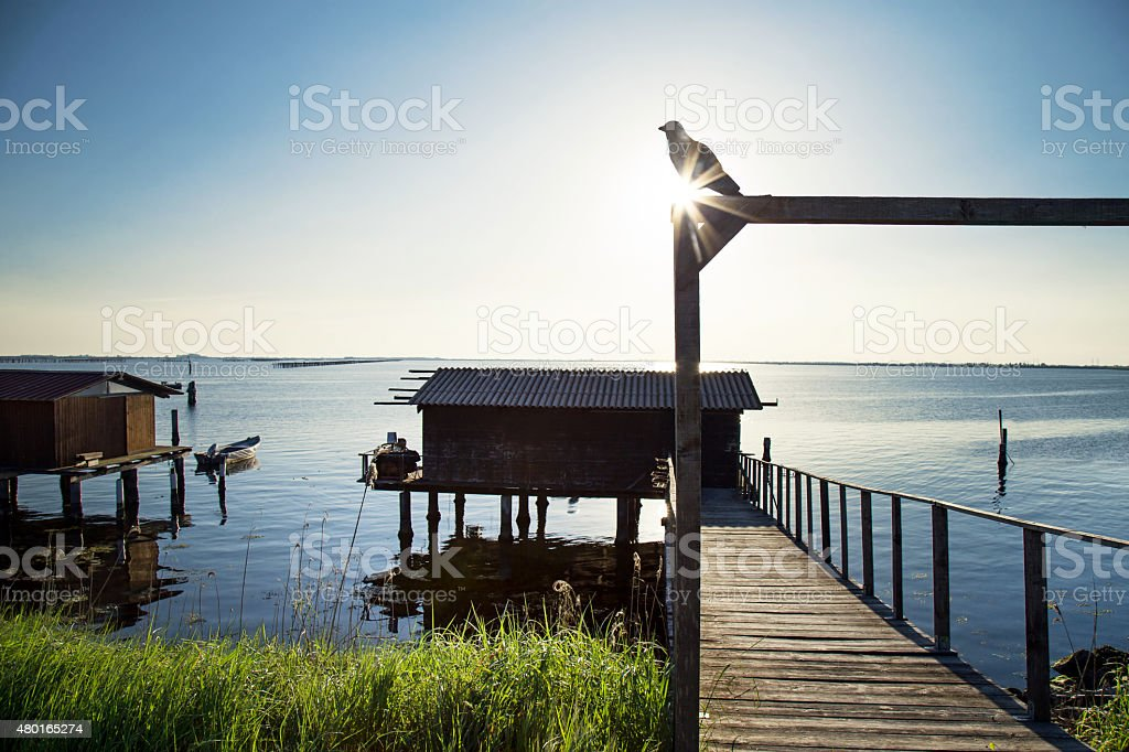 prehistoric House on the water for fishermen stock photo