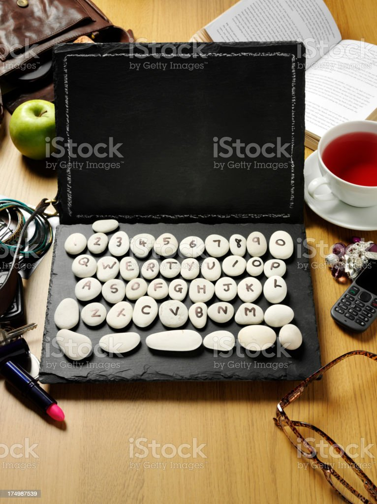 Prehistoric Laptop Computer with Social Items royalty-free stock photo