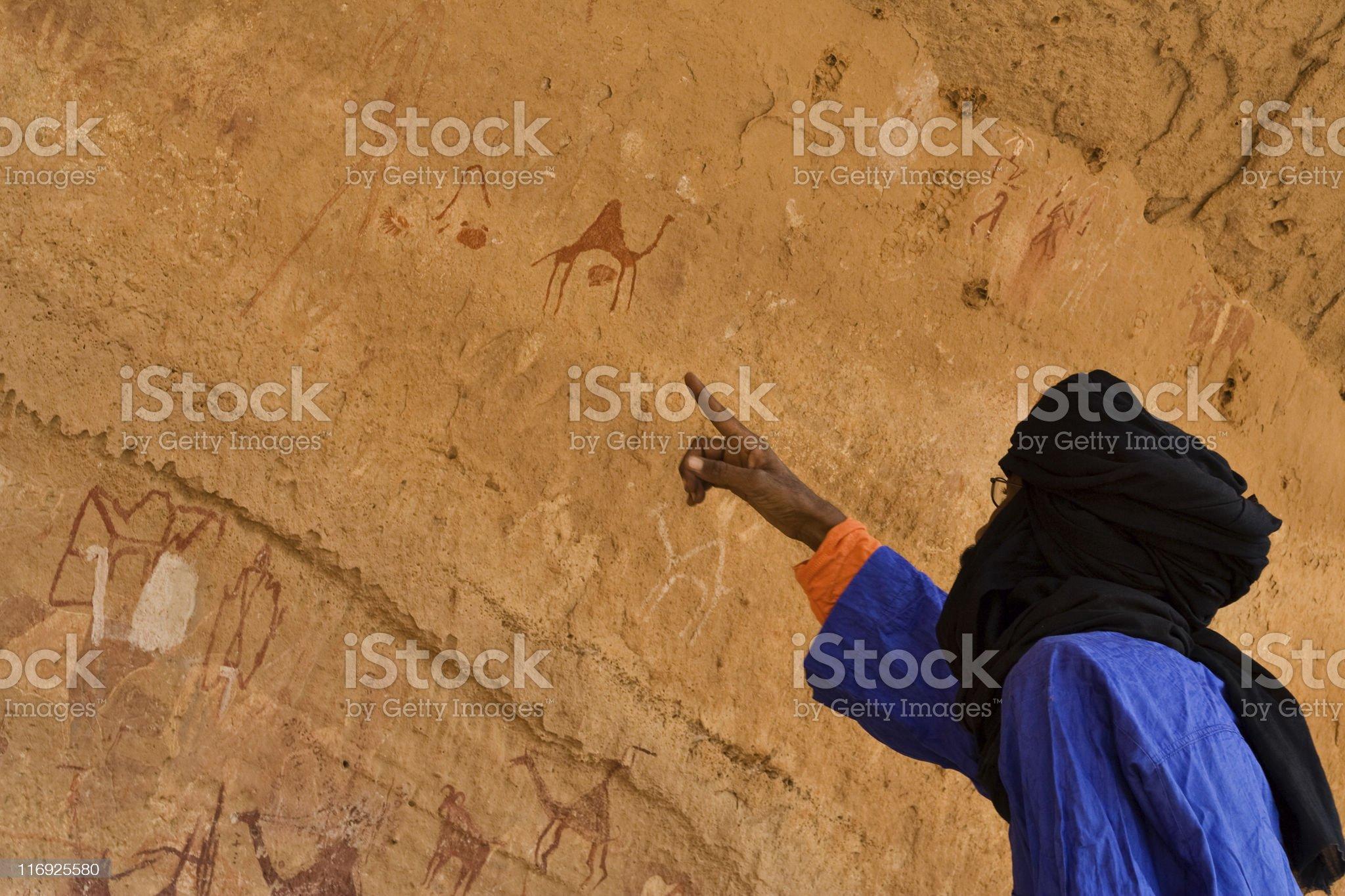 Prehistoric Libyan rock paintings - Acacus Mountains ( Libya ) royalty-free stock photo
