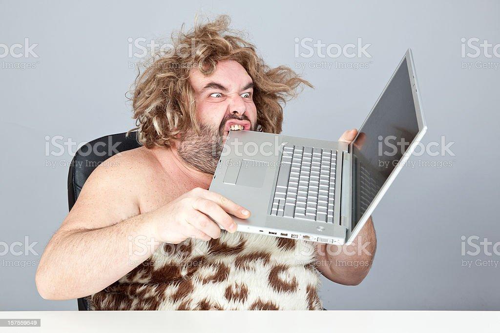 prehistoric man on laptop royalty-free stock photo
