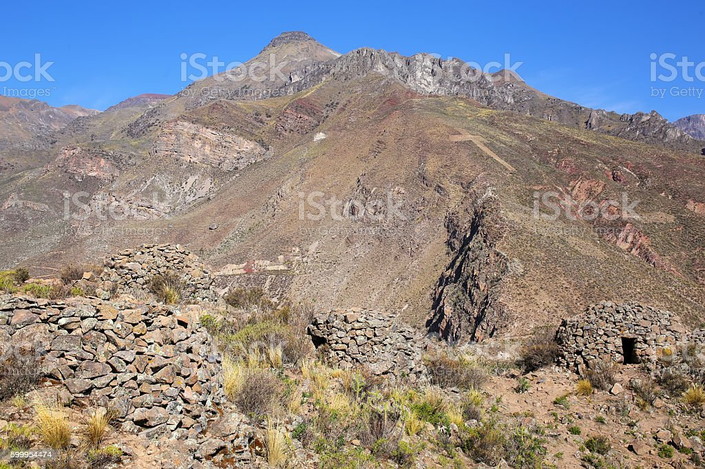 Pre-Incan round houses named colca near Chivay in Peru stock photo