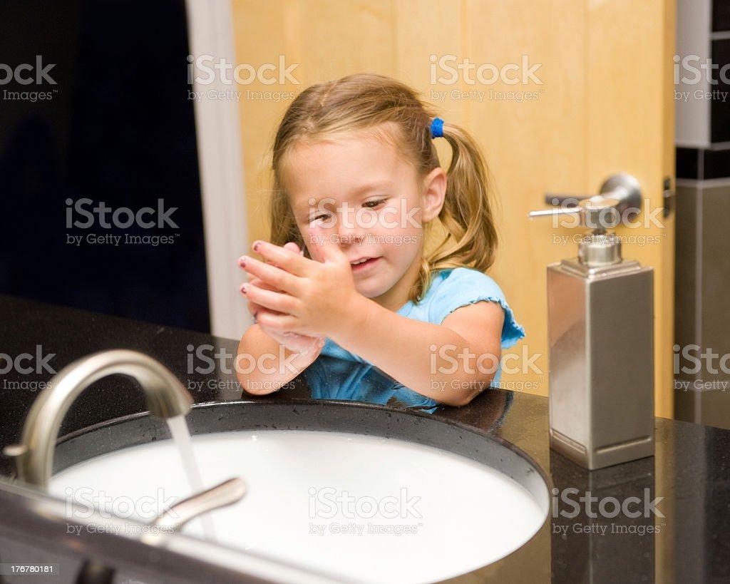 Pre-K Girl Practicing Good Handwashing stock photo