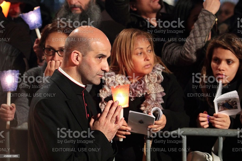 Prelate during Stations of the Cross chaired by Pope Francis stock photo