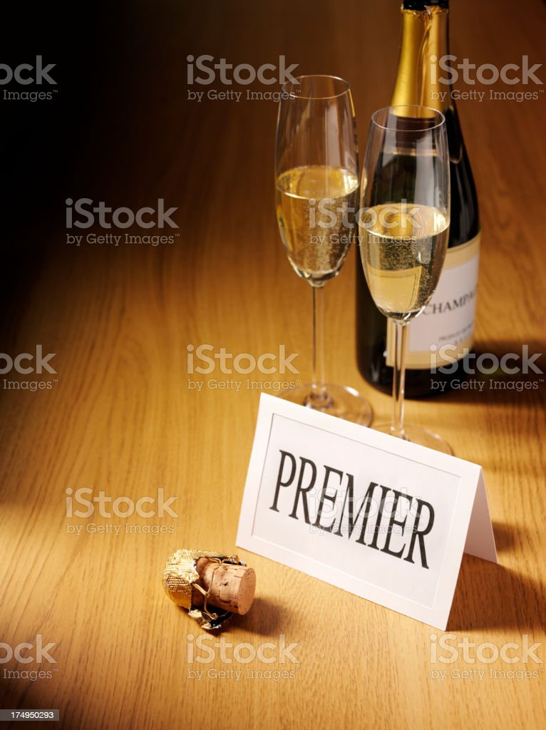 Premier Card with Champagne Glasses on a Desk royalty-free stock photo