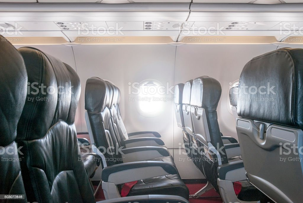 Premium Economy Class Leather Seating Inside An Airplane Cabin stock photo