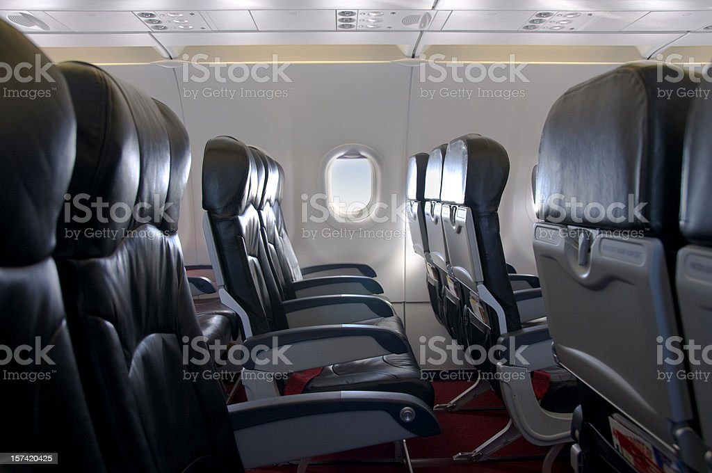 Premium Economy Class Seating Inside An Airplane Cabin stock photo