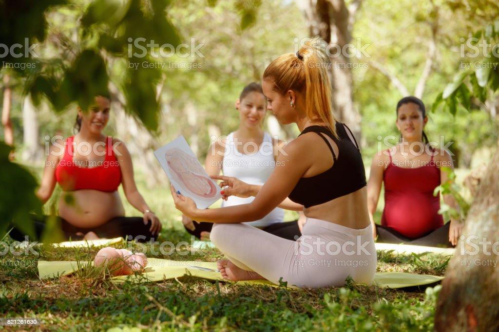 Prenatal Class With Teacher And Pregnant Women stock photo