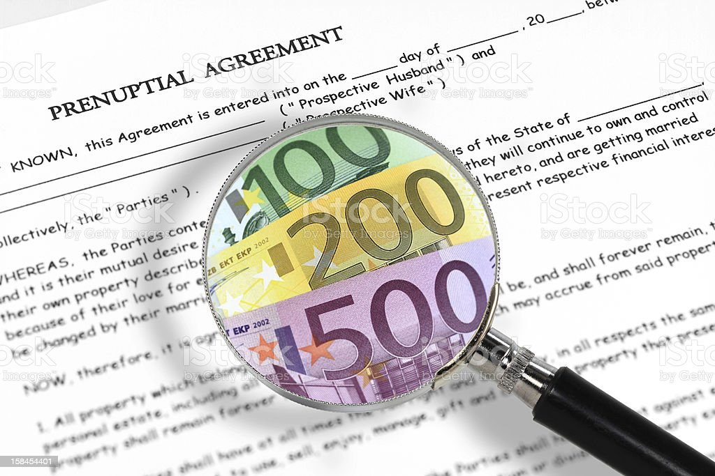 Prenuptial agreement, magnifying glass and euro notes stock photo