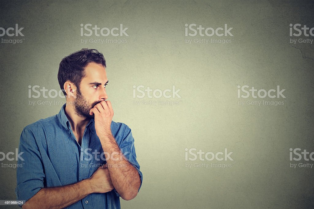 Preoccupied anxious young man stock photo