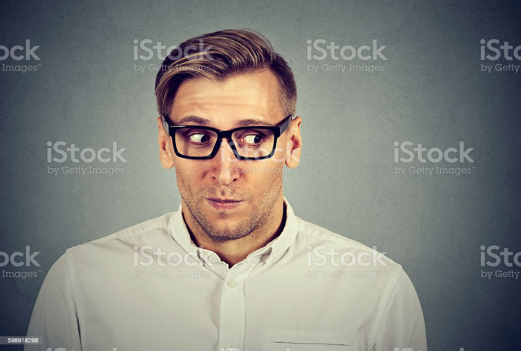 Preoccupied worried man in awkward situation stock photo