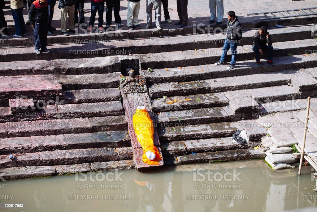Prepairing for Hindu ritual of cremation in the Pashupatinath temple. stock photo
