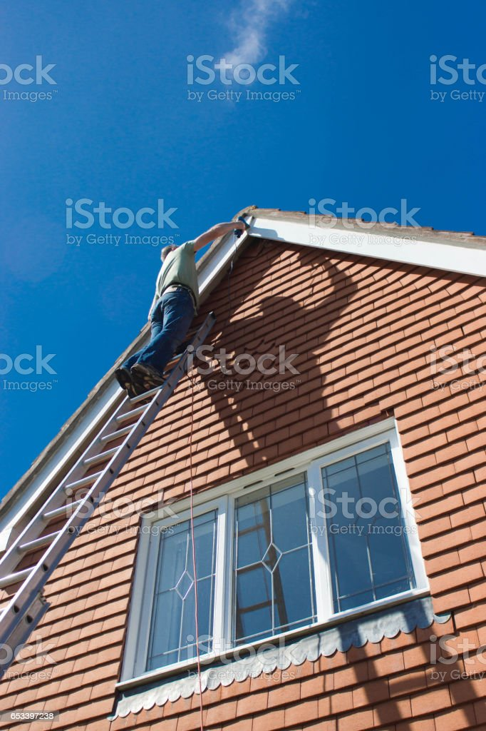 Preparation and painting eves of a house stock photo