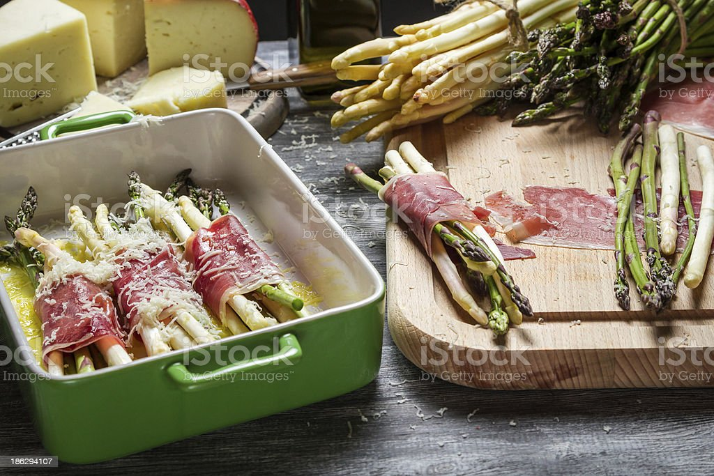 Preparation asparagus with prosciutto ham and cheese royalty-free stock photo