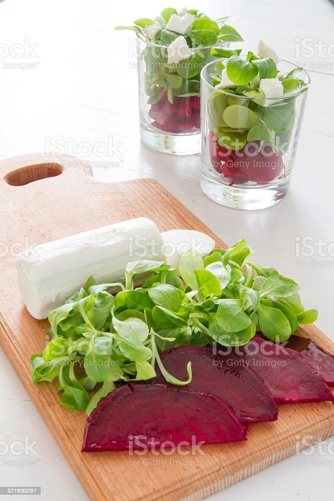 Preparation - Beet root salad on wood board stock photo