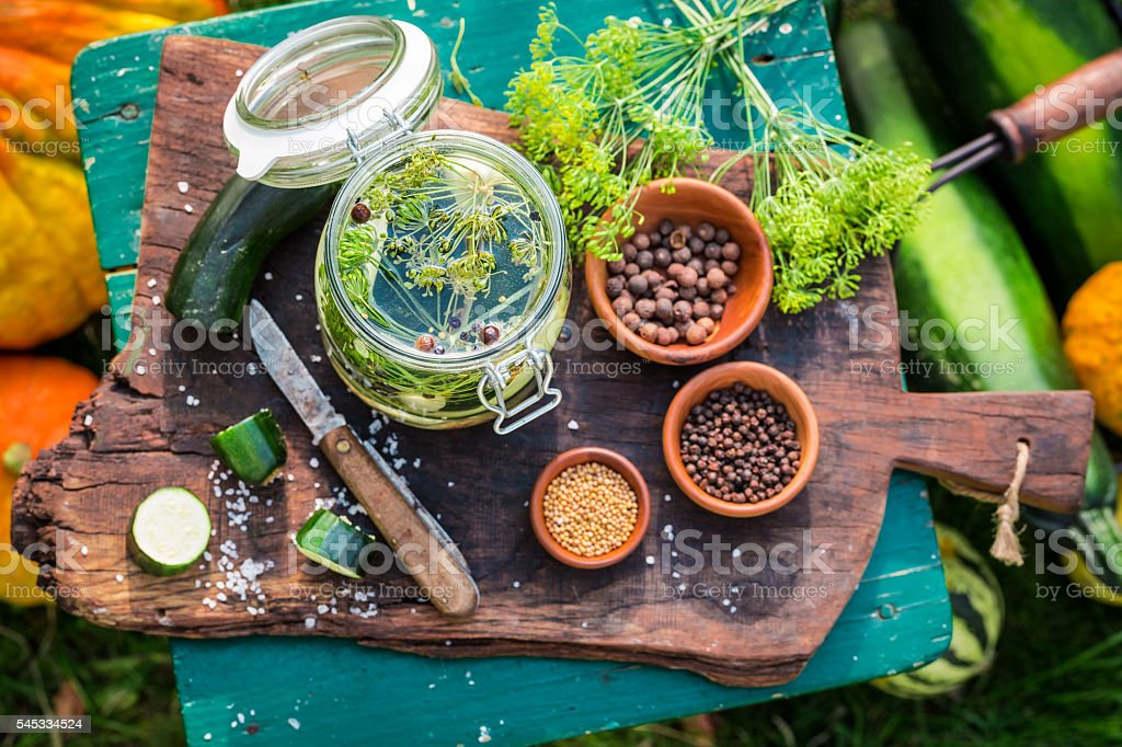 Preparation for pickled courgettes with spices stock photo