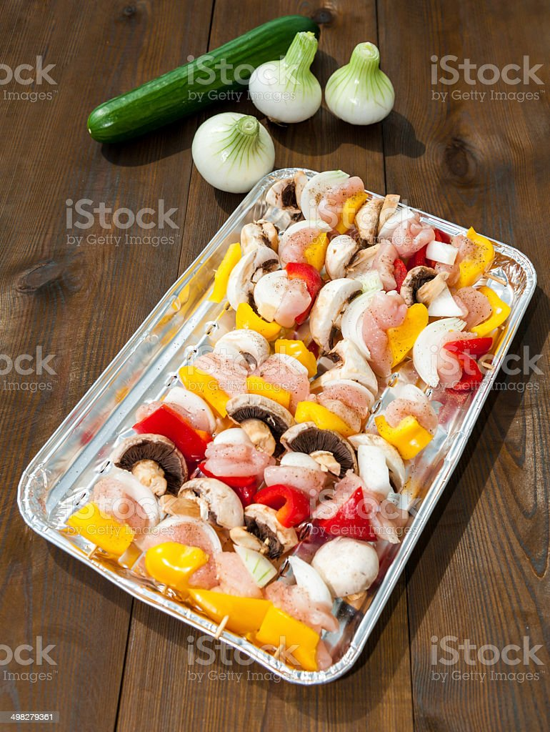 preparation for the barbecue - raw skewers on a tray stock photo