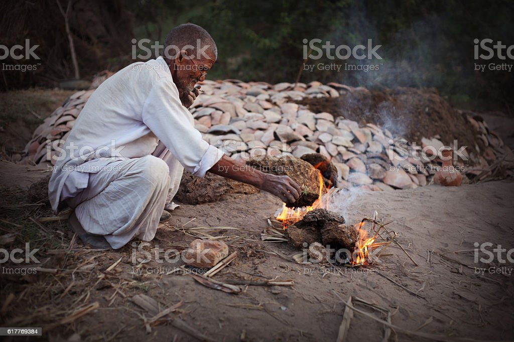 Preparation for the pot baking in furnace using cow dung stock photo