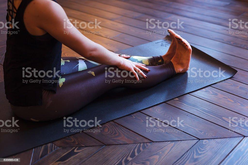 Preparation for the practice of yoga, doing dandasana. Staff Pose stock photo