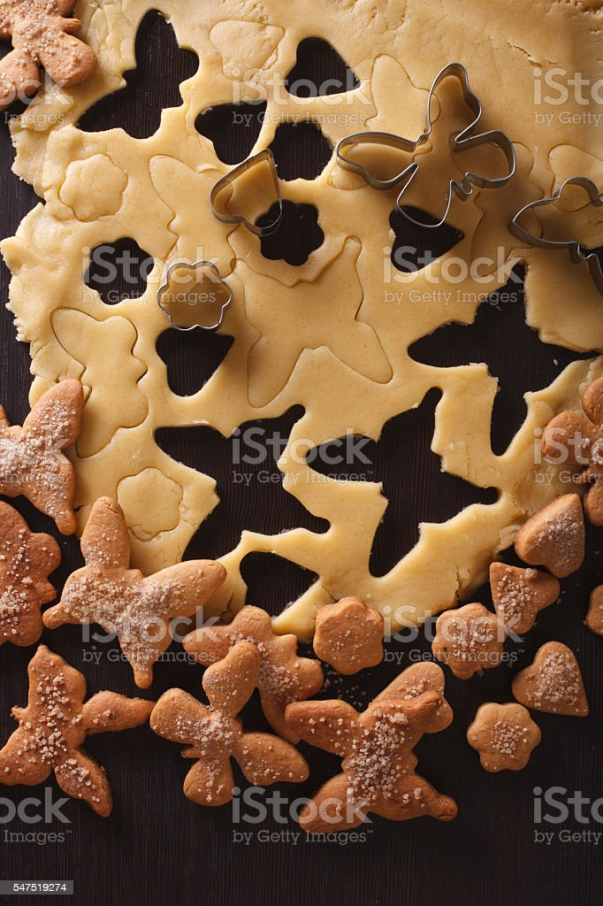 Preparation of a butterfly shaped cookies closeup. vertical top stock photo