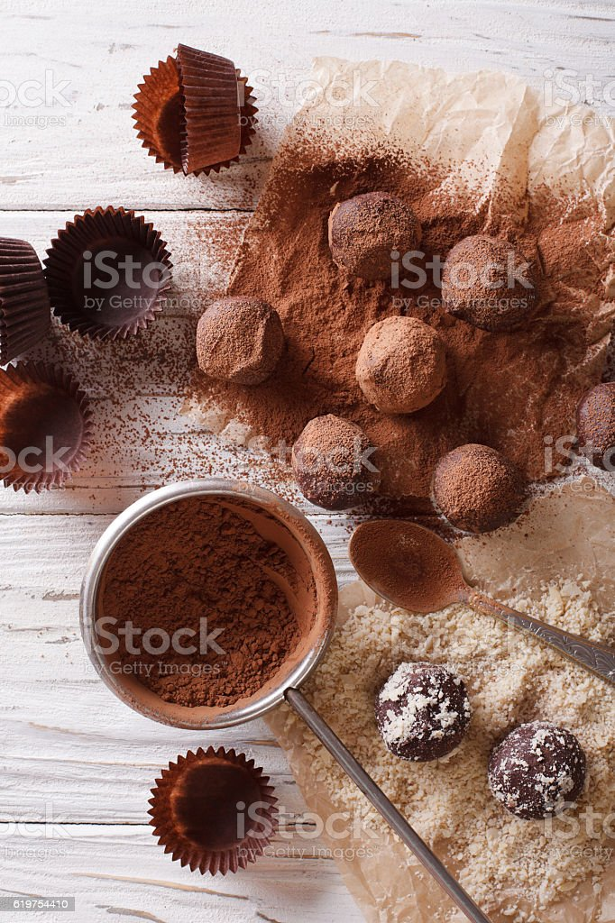 Preparation of chocolate truffles. vertical top view stock photo