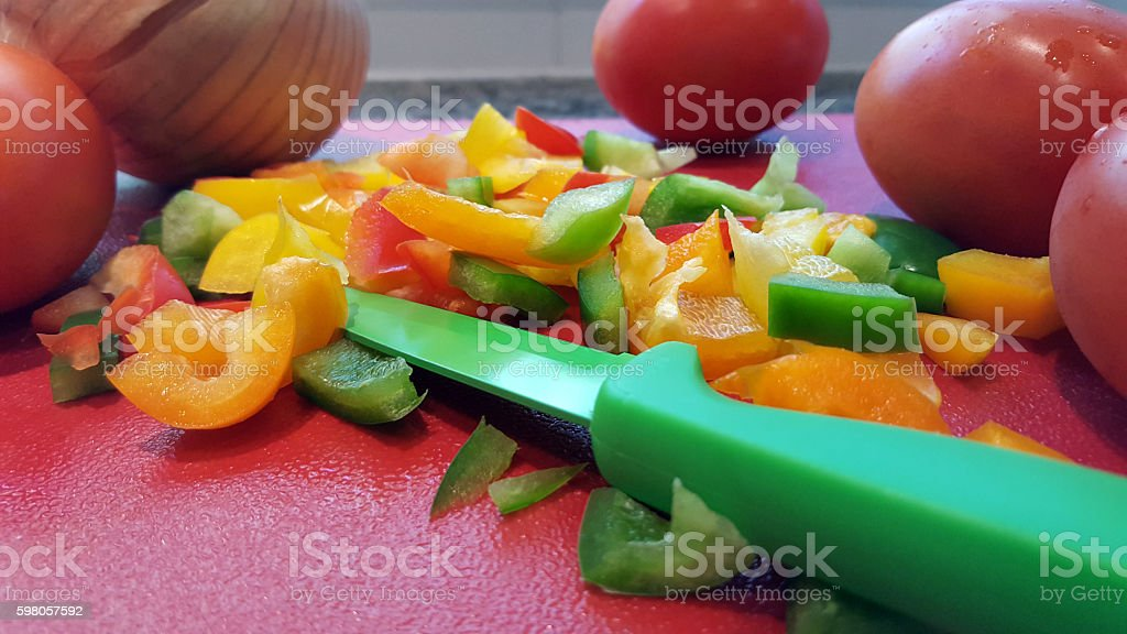 Preparation Of Fresh Peppers,Tomatoes And Onions For the Chilli stock photo
