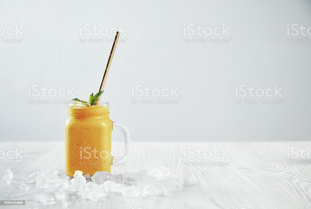 Preparation of healthy fruit berry smoothie process stock photo