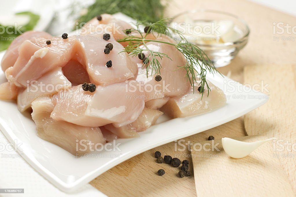 Preparation of raw chicken breast royalty-free stock photo
