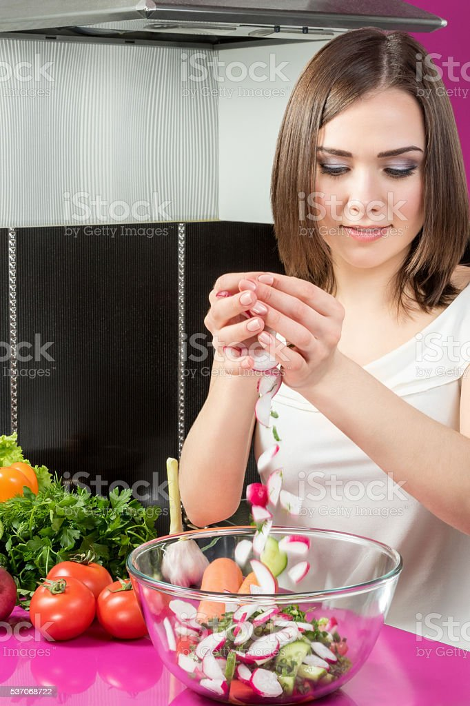 Preparation of salad in the kitchen stock photo