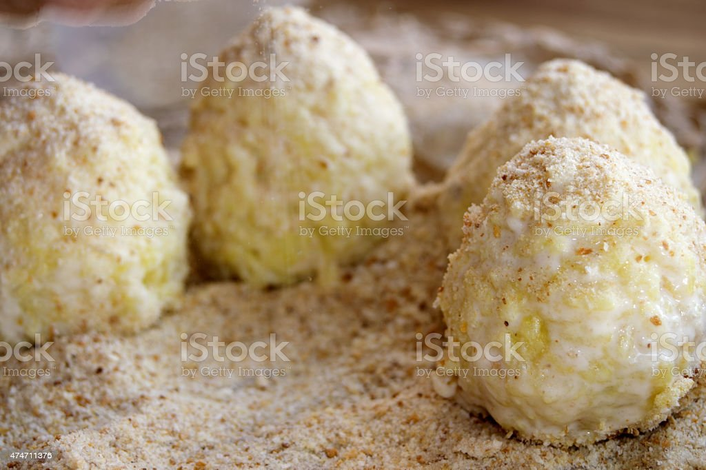 preparation of sicilian arancine stock photo