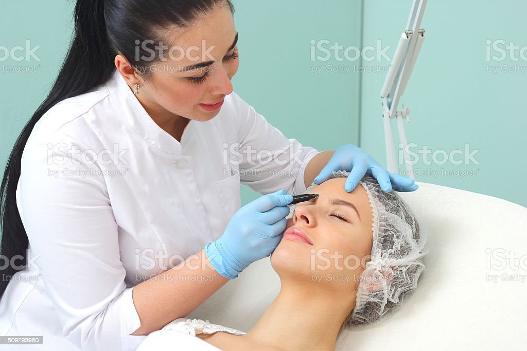 Preparation of the patient's face to a cosmetic procedure. royalty-free stock photo