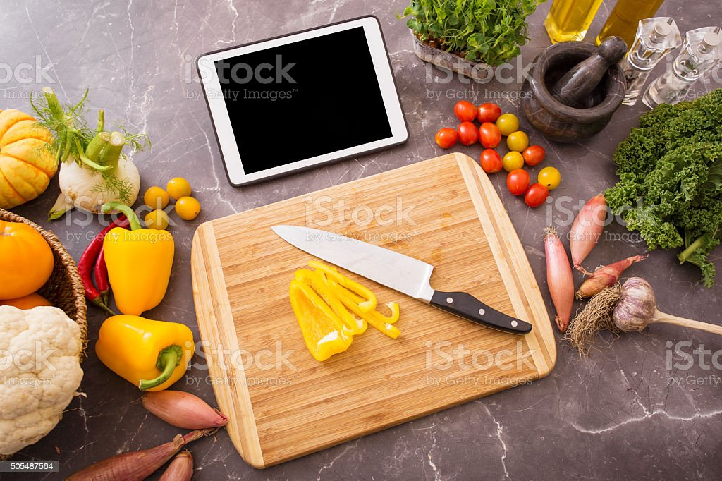 Preparation table in kitchen for cooking with tablet stock photo
