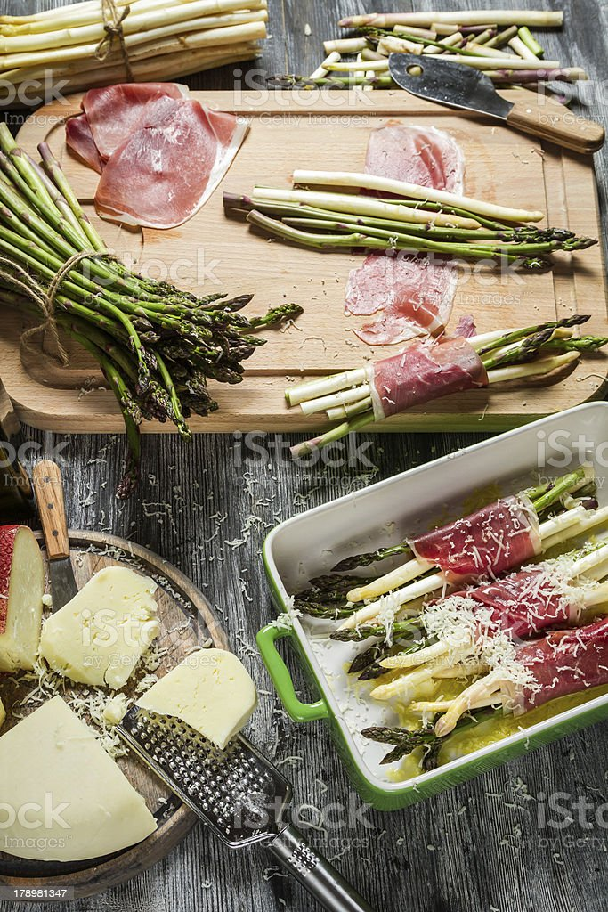 Preparations for the casserole with asparagus and cheese royalty-free stock photo