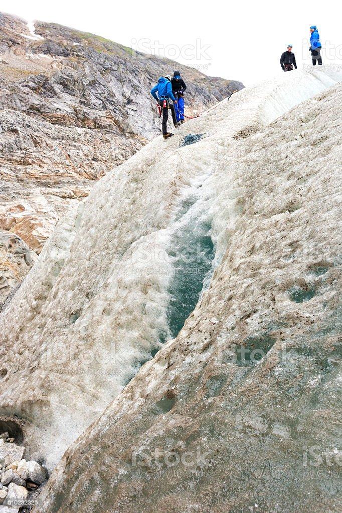 Prepare to rappel down a glacier stock photo