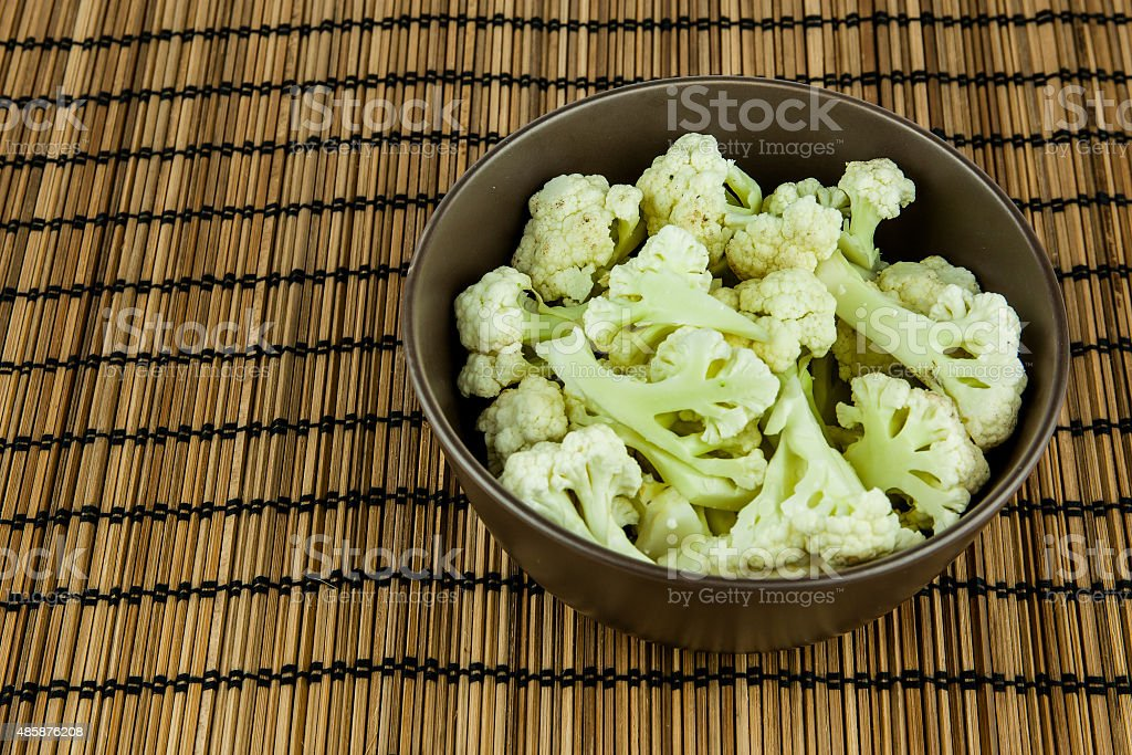 Prepared Cauliflower decorated in bowl over wooden background stock photo